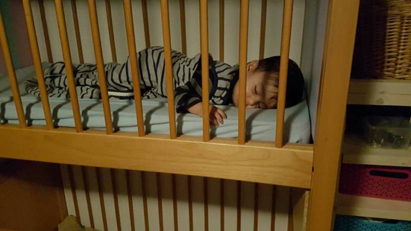 Child sleeping in a sturdy bunk bed